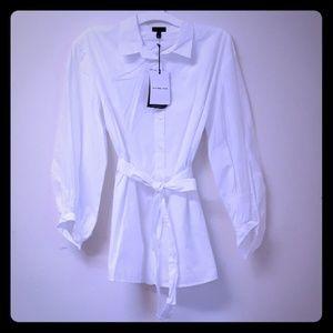 Bright white womens button down dress shirt.